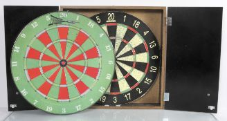 Two dart boards and some darts