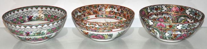 Three Oriental famille rose bowls 23 cm wide