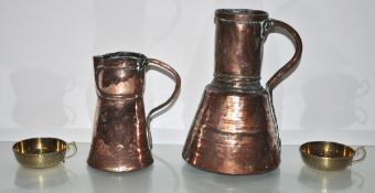 Two Iranian copper ewers and two brass candlesticks