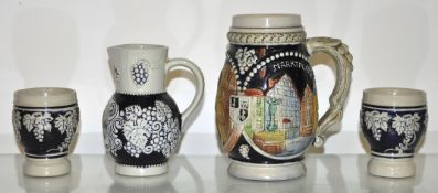 A group of German stoneware blue glazed drinking vessels (4)