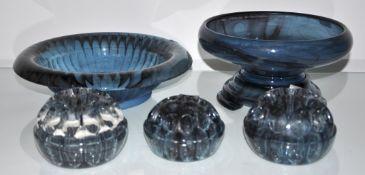 A blue glass bowl, three flower hedgehogs and a cut glass bowl