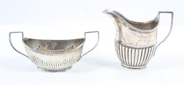 A silver milk jug, of traditional oval form with a half ribbed body, London 1903, 10cm high,