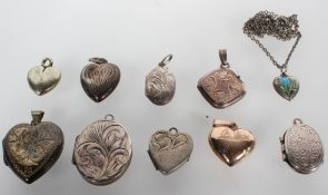 A collection of ten pendants of variable designs; most are lockets.
