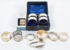 A collection of napkin rings, to include a Britannia Standard matted and bright cut example,