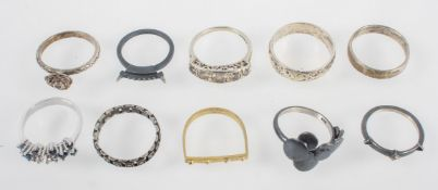 A collection of ten dress rings.