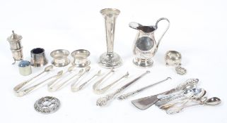 A collection of silver items, to include two concave napkin rings with bead edges, Chester 1918,