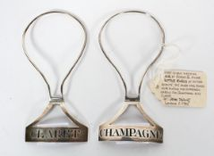 Two 18th century silver ring bottle tickets, of shaped plain rectangular form,