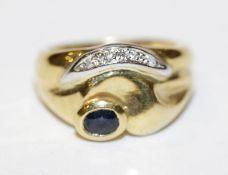 18 k Gelbgold Ring mit Safir und in Weißgold gefaßten Diamanten, 9,8 gr., Gr. 53