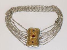 Silber Kropfkette, 8-reihig mit teils vergoldeter, filigraner Schließe und 3 Granaten, L 36 cm