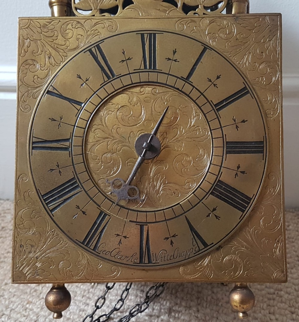 Lot 75 - A mid 18thC brass lantern clock by George Clarke of Whitechapel, striking on a bell, with weight and