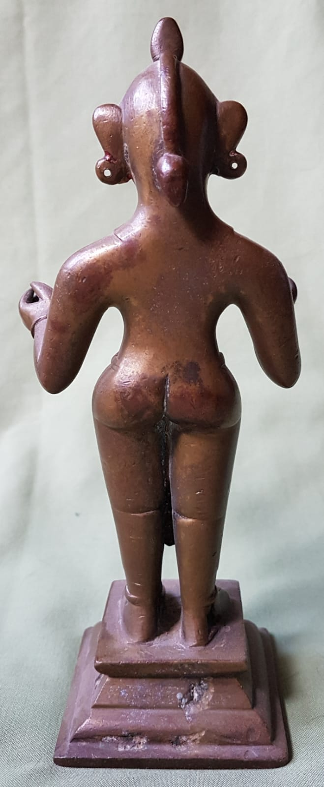 """Lot 62 - An antique Indian brass female figure - traces of red wax, 9"""" high."""