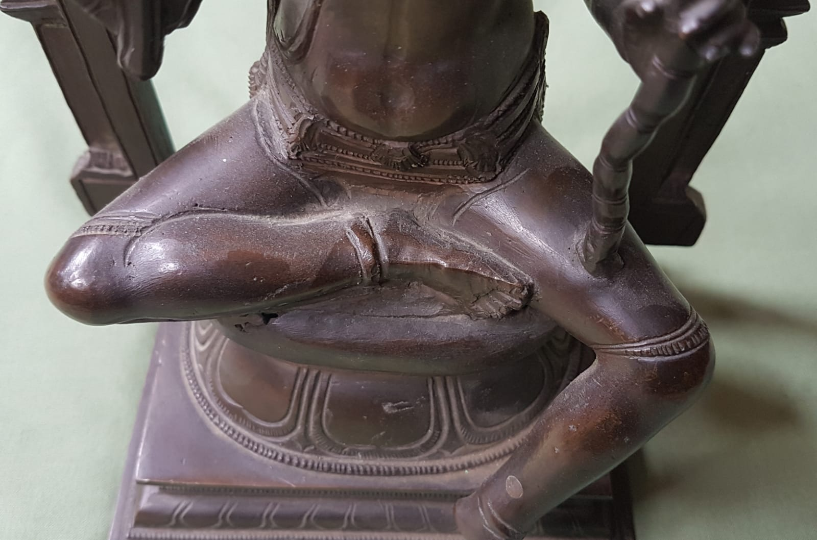 Lot 61 - An antique Indian bronze sectional figure depicting a seated female deity beneath an arch, 12""