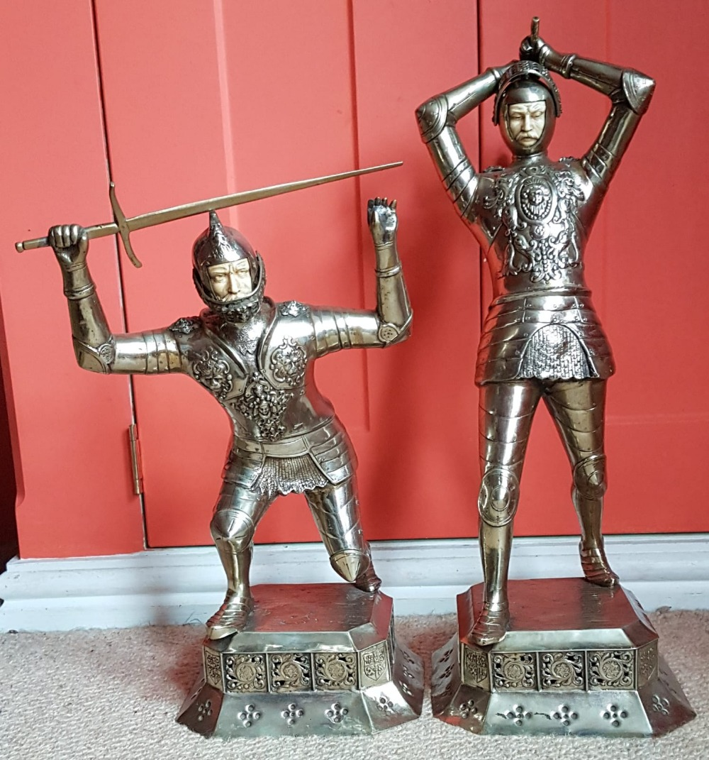 "Lot 55 - A large pair of 'German Silver' knights in combat - 'ES', 18""."
