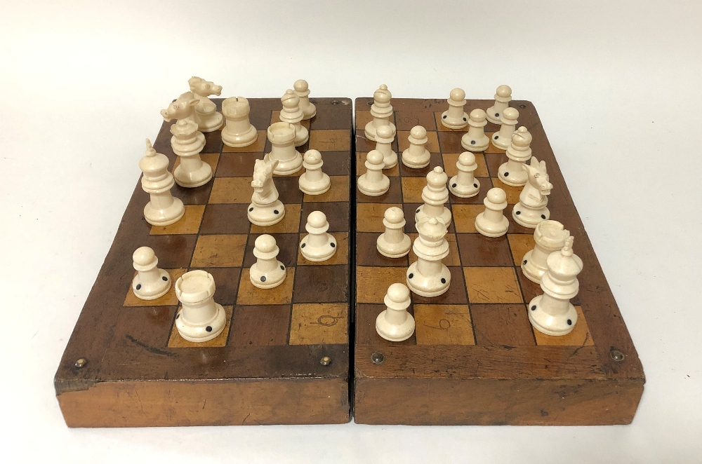 Lot 68 - A late 19th/early 20thC ivory chess set with folding games box.