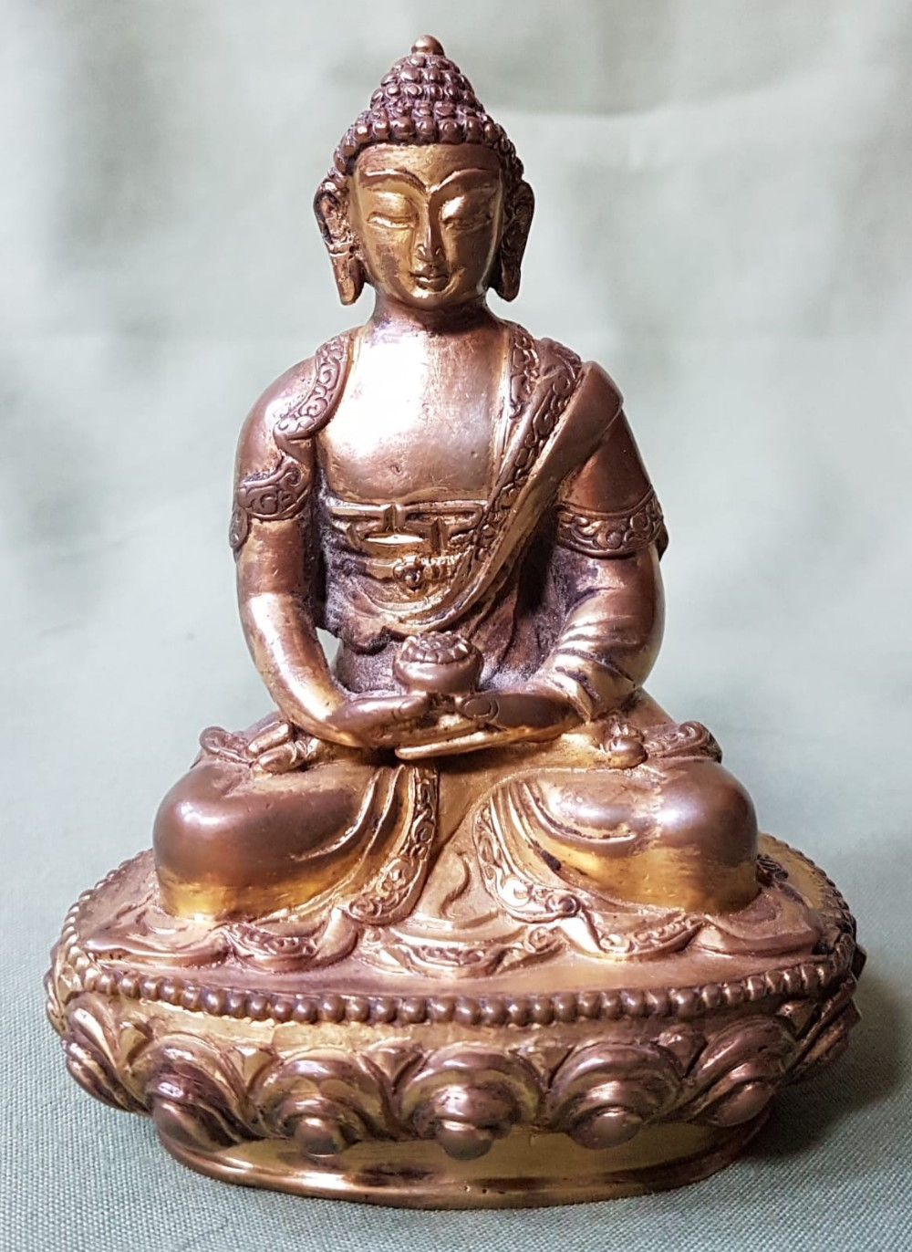 """Lot 60 - A small antique gilt bronze seated Buddha - much gilding remaining, 3.75"""" high."""