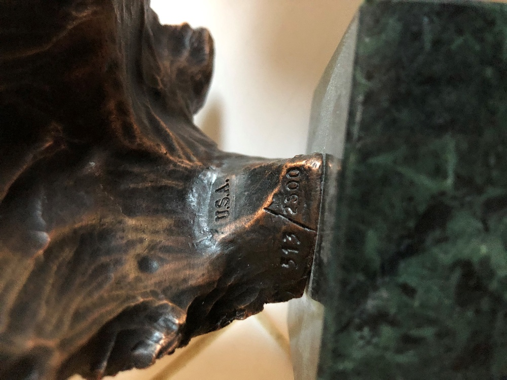 Lot 77 - An American painted bronze limited edition study of a bald eagle's head on square black marble