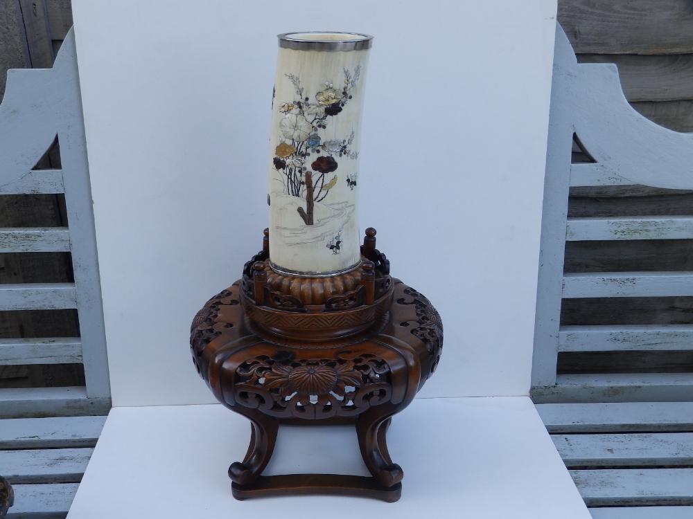 Lot 90 - A signed Japanese Meiji period shibayama inlaid ivory tusk vase with silver rims, the sides