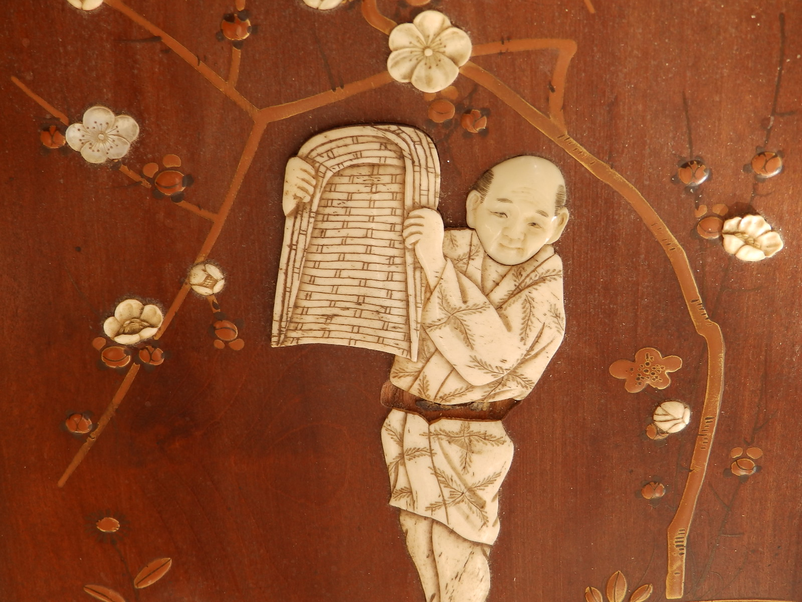 """Lot 97 - Two Japanese Meiji period wooden panels inlaid with ivory and having gold lacquerwork details, 11"""" x"""