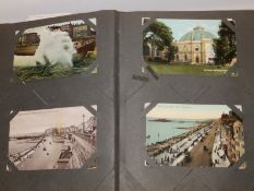 An old album containing approximately 100 postcards, together with an album containing approximately