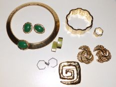 A Monet gilt metal choker with green cabochon and matching earrings, a Swatch bracelet and ring, two