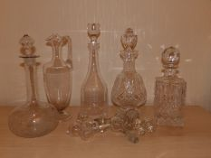 Four various decanter, a ewer and six stoppers.
