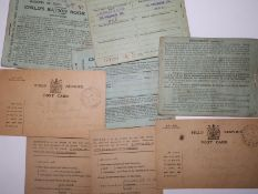 Five WWI Child's Ration Books bearing London stamps, together with four Field Service Post Cards -