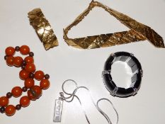 An Yves Saint Laurent gilt metal choker necklace and matching bracelet of heavy strap form, a modern