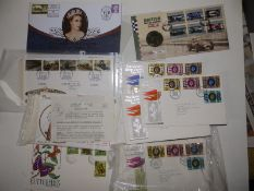 QEII Silver Jubilee First Day Covers and others, together with a folder containing cigarette cards.