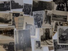 A collection of small WWII photographs depicting German troops, Hitler Youth and including snow