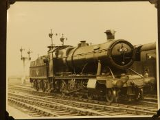 """An album containing 42 20thC black & white photographs of steam trains, the majority 6"""" x 8"""", some"""