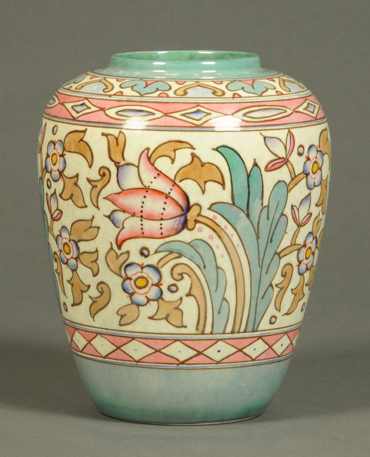 Lot 26 - A Charlotte Rhead Bursley ware vase, tube lined and decorated with bellflower and other foliage.