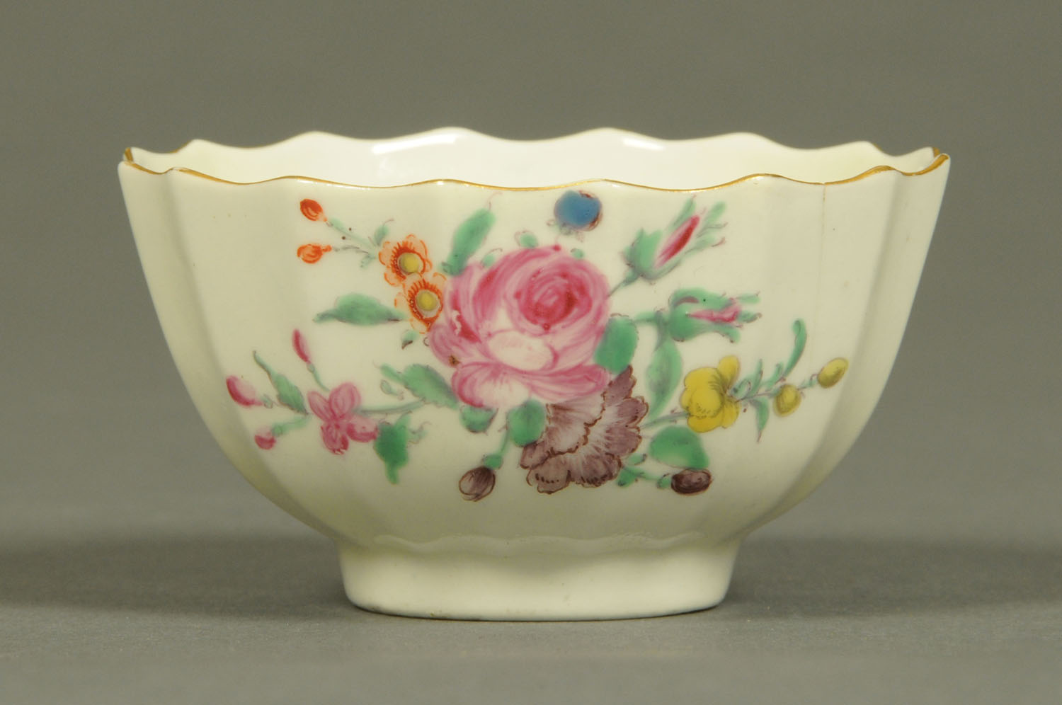Lot 25 - A Worcester fluted tea bowl, polychrome, decorated with floral bouquet and sprigs.