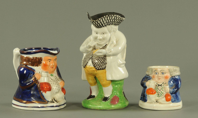 "Lot 44 - A Staffordshire pearl ware figure ""The Snuff Taker"","