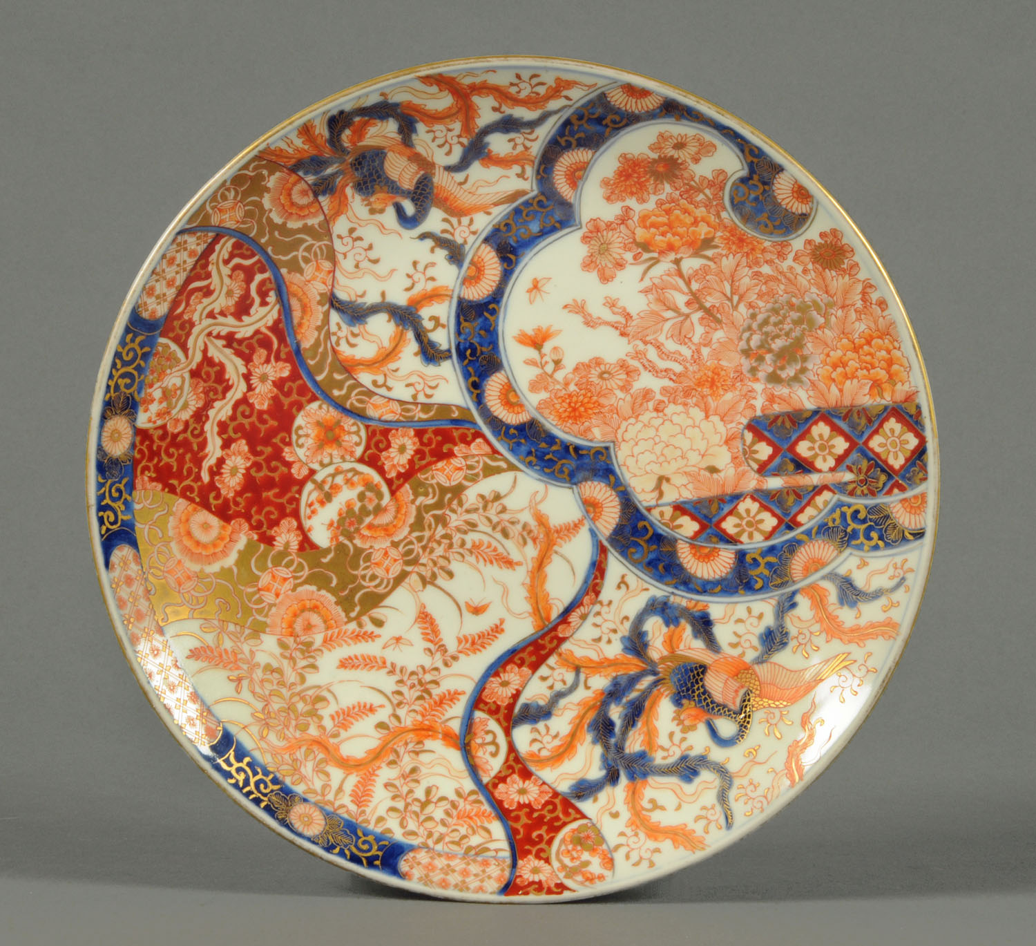 Lot 10 - A Japanese Imari plate, late 19th century, decorated in typical Imari colours with gilding.