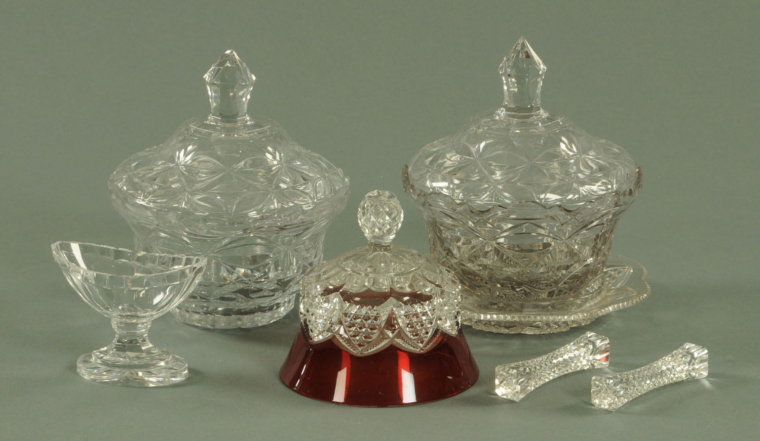 Lot 53 - A pair of cut glass bowls and covers, one with stand, height 20 cm, a pair of cut glass knife rests,