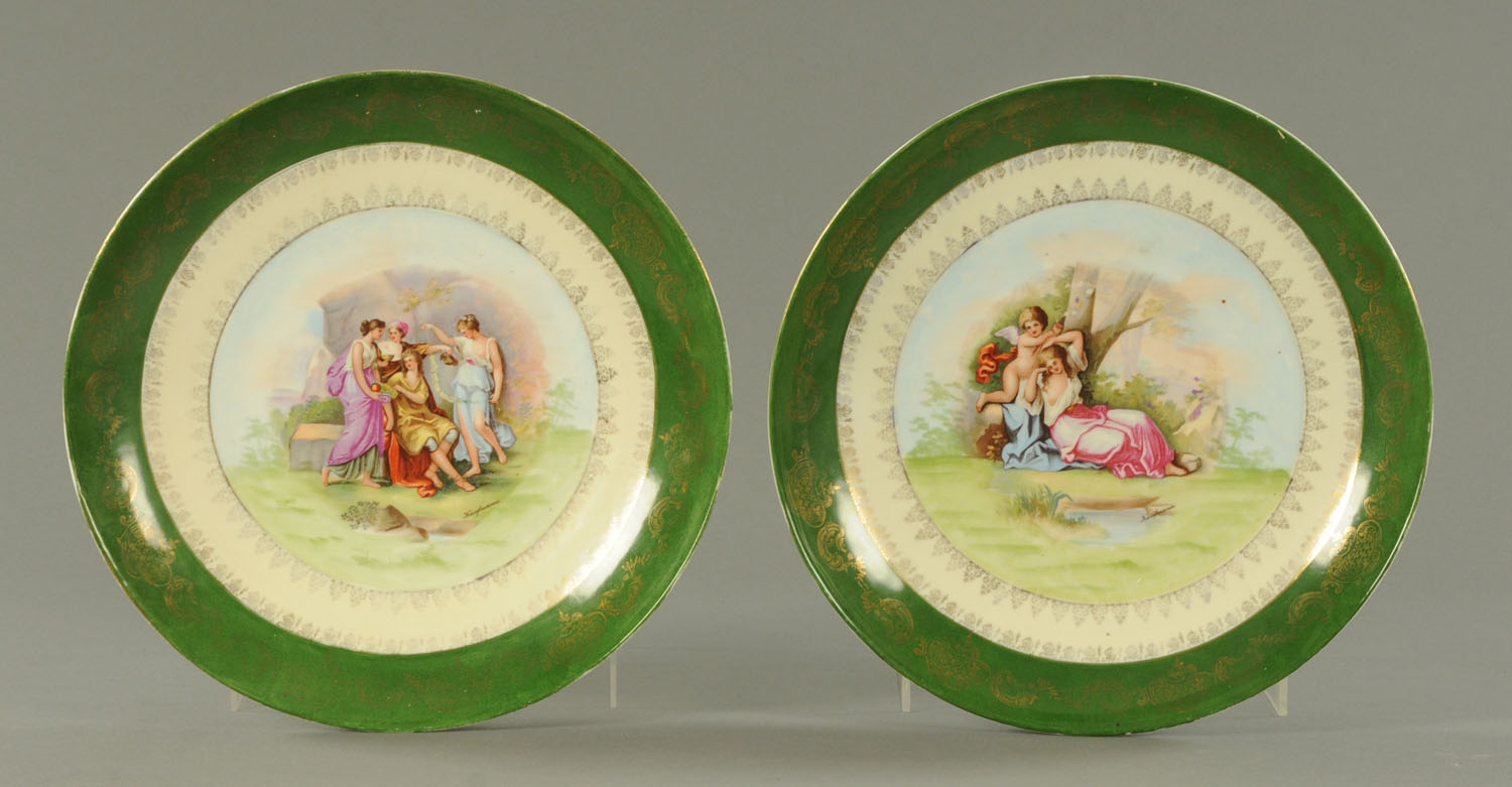 Lot 33 - A pair of Vienna plaques, with green borders and printed Kauffman scenes to the centre.