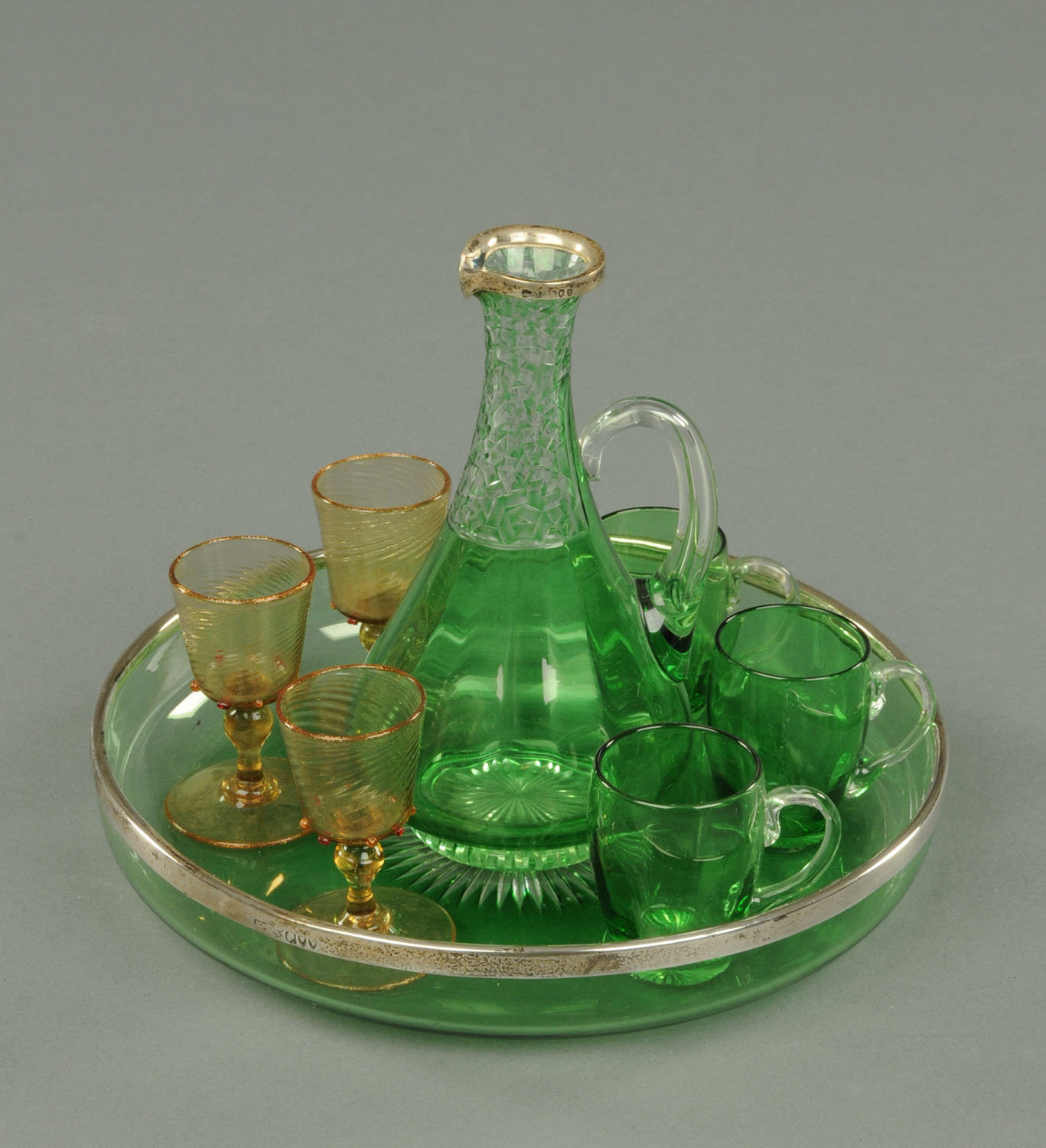 Lot 14 - A green glass silver mounted liqueur flask, hallmarked to the rim London 1894,
