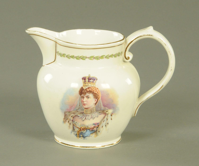Lot 59 - A George V milk jug, transfer printed with Princess Mary. Height 14.5 cm.