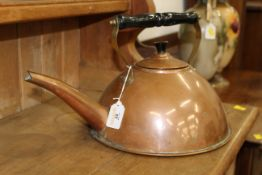 Copper kettle with ebonised and brass carrying handle,