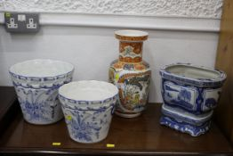 Two blue and white Portuguese floral patterned planters,