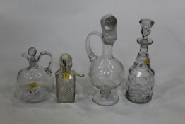 Four glass decanters,