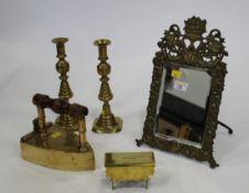 Brass decorative mirror, two candlesticks,