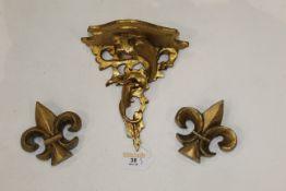Italian made giltwood corbal/shelf and two gilt Fleur de Lis