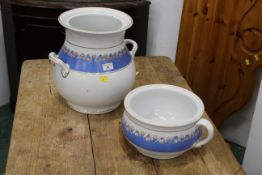 Floral jug with two carrying handles and a matching chamber pot,