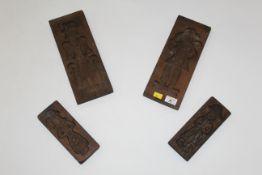 Four oak biscuit moulds,