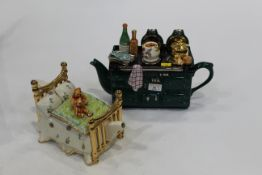 Two novelty teapots,
