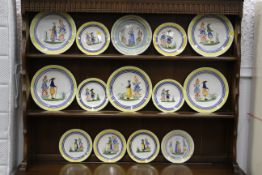Fourteen pieces of French Quimper tableware,