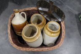Basket of stainless steel nut dish, four stoneware storage jars, jugs with stoppers, brass bell,