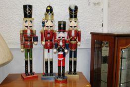 Four festive soldier Nutcracker figures,