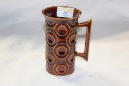 "A Portmeirion ""Jupiter"" brown glazed pottery tall cylindrical mug with flared rim,"